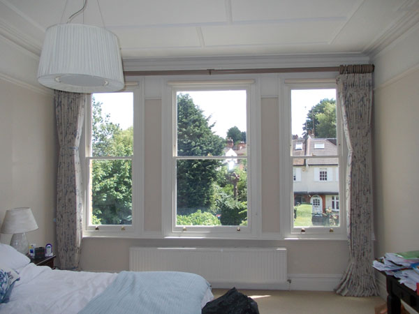 embroidered curtains on wooden pole with voile blinds installed in highgate north london by changing curtains