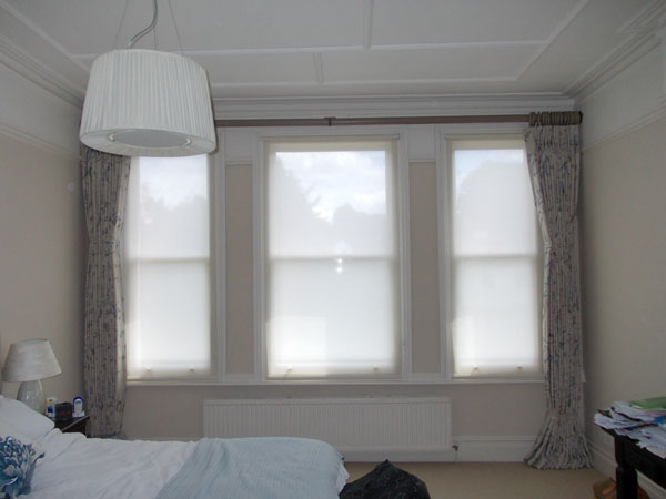 wall to wall wooden pole and curtains with voile privacy blinds