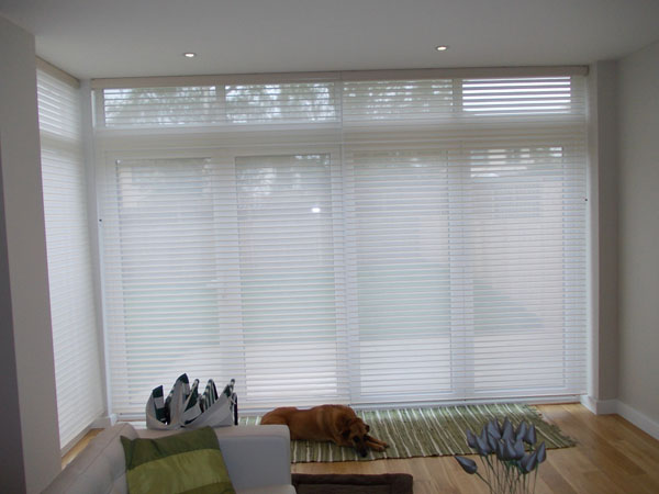 installed in north london by changing curtains silhouette shades lowered for privacy with a view