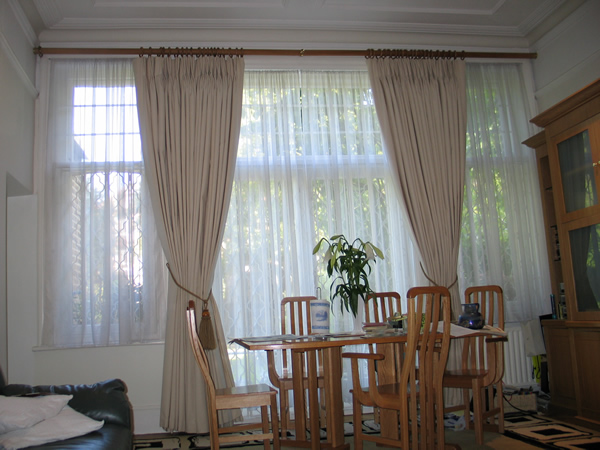 Calico curtains suspended from a 50mm wooden pole. Recess brackets at ...
