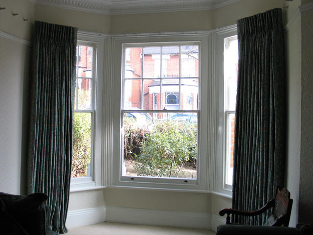Bay window curtain track fixed to ceiling of bay - Changing Curtains