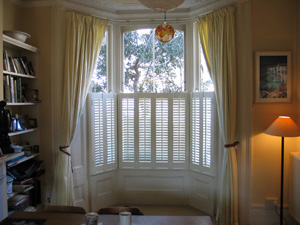 cafe style or half height shutters with 47mm louvres for privacy Archway