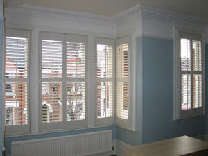 Full height shutters with 63mm louvre and a midrail for excellent control of privacy and light Highgate